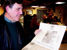 David Stone holds a newspaper account of his Silver Star mission during Operation Desert Storm.