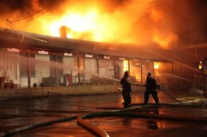 Crews battle a blaze at Southern States Farm & Garden, at 216 W. Franklin St. in Warrenton on Feb. 2, 2011. (Photo by Richard Poythress)