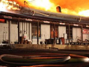 Crews battle a blaze at Southern States Farm & Garden, at 216 W. Franklin St. in Warrenton on Feb. 2, 2011. (Photo by Richard Poythress)