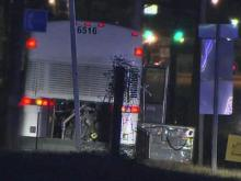 A Greyhound bus that was hijacked along Interstate 85 by a gunman Thursday night sits by the side of the road in Vance County early Friday. All 35 passengers and the driver escaped unharmed, authorities said.