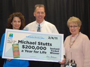 Michael Stutts, 53, received a check Friday, Feb. 4, after becoming the first winner of the North Carolina Education Lottery's new game, $200,000 a Year for Life.