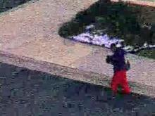 A man wearing red pants left a Cary bank with a gun to the head of a woman. Police then shot him.