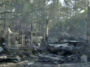 A fast-moving brush fire extensively damaged two mobile homes near ay Road and Rainey Drive in the Twin Lakes area of Harnett County Saturday, Feb. 19, 2011. A family of seven was displaced.