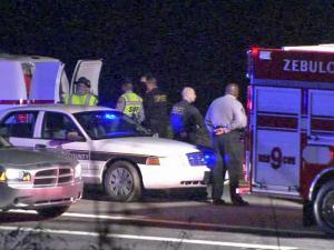 Authorities and emergency crews respond to a wreck along U.S. Highway 64 in Zebulon late Saturday, March 6, 2011. Daniel Scott Barnes, 22, of Bailey, died in the wreck, which came after a high-speed chase from Raleigh.