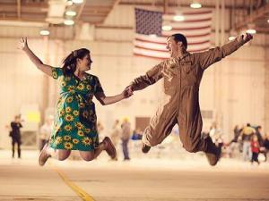 Hilary and Neil Mercer jump for joy at Seymour Johnson Air Force Base in March 2011. (Photo courtesy of Reminiscing Moments Photography)