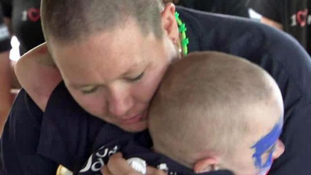 Kathleen Henry, the Fayetteville mother of two sons with cancer, shaved her head Saturday for the St. Baldrick's Foundation, a charity that funds childhood cancer research, and hopes to raise $10,000 for the cause.