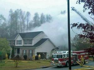 A small plane crashed into a house on Devane Court in High Point on Wednesday, March 30, 2011, killing the pilot and a passenger. (Photo courtesy of WFMY)