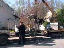 Plane wreckage removed from High Point home
