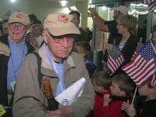Local veterans return from Triangle Flight of Honor