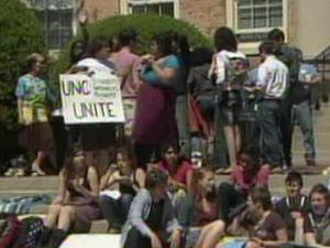 About a dozen maintenance workers and more students held a sit-in at the University of North Carolina at Chapel Hill on Thursday, April 7, 2011, to protest proposed changes to workers' schedules.