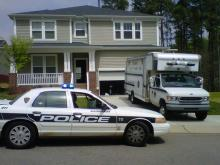 Durham police returned to 2109 Pear Tree Lane on April 11, 2011, to search the home for evidence in the disappearances of a boy and a woman.