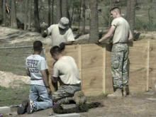 soldiers repair fence