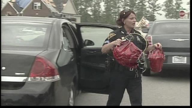 Fayetteville police delivered Easter baskets Saturday to storm victims.
