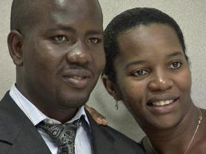 A couple smiles for the camera after exchanging vows at the Wake County Courthouse Friday.