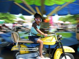 Festival goers enjoy rides during the annual Dogwood Festival in Fayetteville, NC on April 30, 2011. (Photo by Lance King)