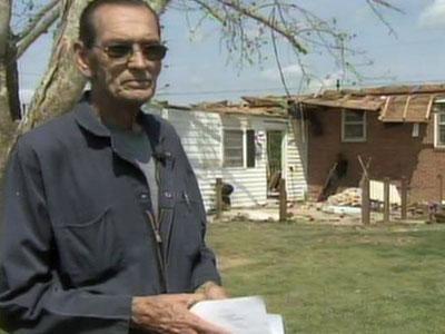 An April 16, 2011, tornado took the roof off Willie Wrench's home in Dunn and knocked out one side of the house.