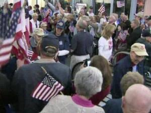 Crowds gathered at Raleigh Durham International Airport to give a heroes' welcome to Triangle veterans who participated in the Flight of Honor to Washington, D.C., on May 4, 2011.