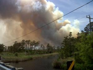 Firefighters set a backfire near Stumpy Point Bay in Hyde County on May 10, 2011, to help contain a wildfire in the Alligator River National Wildlife Refuge.