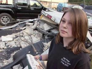 A Lee County girl squeezed out of her father's squashed truck three weeks ago to find help after a tornado flattened a Lowe's Home Improvement store in Sanford.
