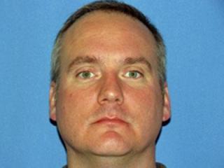 Investigator Warren Lewis
