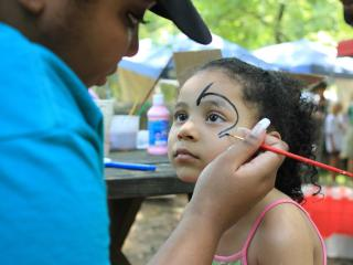 Sheffa Abdullah of Bear Creek has her face painted during the opening day of the 2011 Festival for the Eno in Durham on Saturday,  July 2.  The festival, which runs through July 4, features crafts, foods, hands-on exhibilitions and 90 performers on 4 stages.