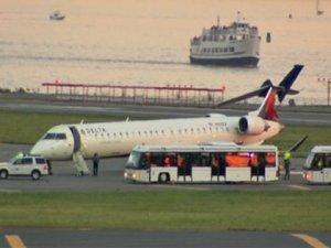 The tail of this Delta regional jet was clipped by a Delta 767 on the runway at Logan Airport on Thursday. (Photo courtesy of CBSBoston.com)