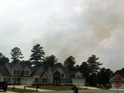 Smoke rises from a fire in a wooded area off of Ponderosa Trail in Cameron on July 19, 2011. (Submitted by Kevin Aucoin)