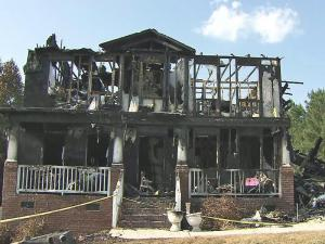 A Garner family is picking up the pieces after a fire ripped through their home on Saturday, killing two of their dogs and sparking concerns from neighbors about the safety of houses in the Meadows community.