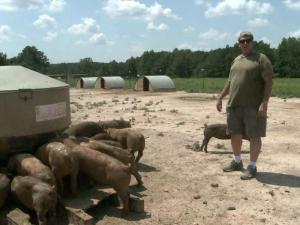 Michael Jones on his Louisburg hog farm