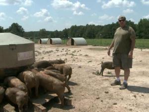 Michael Jones on his Louisburg hog farm