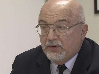 State Crime Lab Director and former judge Joseph R. John, Sr.