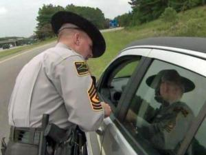 """State Trooper K.W. Cole issues a citation during the """"Operation Booze It and Lose It"""" crackdown on impaired driving and speeding on Labor Day 2011."""