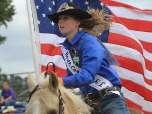Madison Apple carries the American flag during the Benson Mule Days' NCHSRA rodeo on Saturday, Sept. 24.