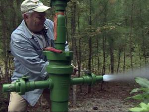 "Test wells in Lee County tap into underground natural gas deposits, but trying to extract the gas has created a debate over a process known as ""fracking."""
