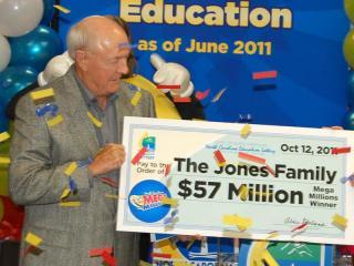 James Jones of Greenville claims half of a Mega Millions lottery jackpot on Oct. 12, 2011.