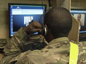 Deployed soldiers use video chats to communicate with family members back home.