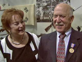 Retired Capt. Lyle Parker, 71, received the Soldier's Award from Rep. Brad Miller at the North Carolina Museum in History in downtown Raleigh on Saturday, Oct. 15, 2011. Parker smiles after his wife pinned the medal on him.