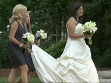Cate Edwards walks into University Methodist Church in Chapel Hill on her wedding day.