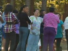 Parents stand outside Cape Fear High School in Fayetteville on Oct. 24, 2011, after hearing news that a teen girl was shot.