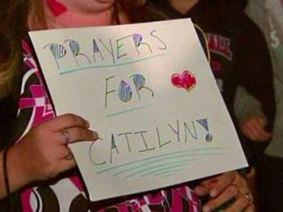About 200 people gathered for a vigil in honor of a 15-year-old Cape Fear Valley High School student who was shot in the neck.