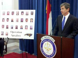 Attorney General Roy Cooper announces the arrest of 24 people statewide on chil pornography charges as part of a state and federal investigation dubbed Operation Spyglass.