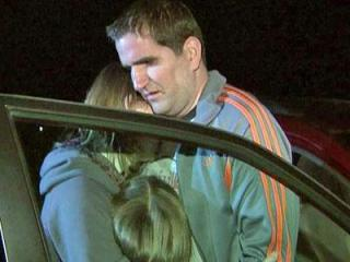 Adam Root is reunited with his wife and daughter after he went missing in Raleigh earlier Nov. 3, 2011.