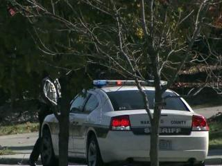 Wake County deputies and other law enforcement officers searched a wooded area of northeast Raleigh on Nov. 7, 2011, after a man in camouflage clothing and carrying a rifle was seen near a school.