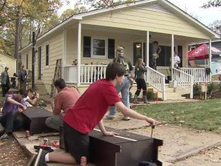 A group of volunteers labored through the weekend to give the McLean family, of Raleigh, a complete home makeover using about $40,000 worth of materials – from the furniture to the landscaping – donated by local businesses.