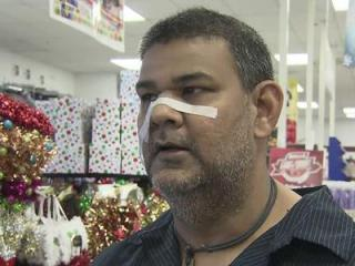 Syed Ali, the loss prevention manager at the Conway Store, says he was cut during a confrontation with a man he believed was trying to steal a coat.