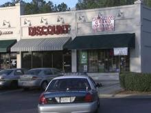 Two men sought in Raleigh tobacco shop shooting