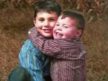 Cullen Reese Parker hugs his older brother, Colby