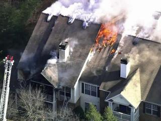 Fire and smoke tear through a Raleigh apartment building, The Enclave at Crossroads, Wednesday morning, Dec. 28, 2011.