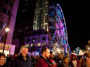 New Year's Eve revelers gather in down town Raleigh for First Night. First Night includes live music, food, as well as many other attractions.