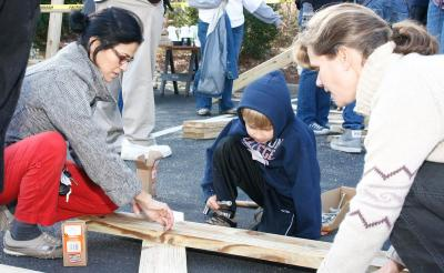 Estela Villalobos, along with Benjamin and Chrishelle Morken, assemble a picnic table during the United Way's Martin Luther King Jr. Day of Service at the Christ United Methodist Church in Chapel Hill.